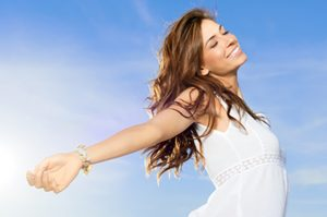 Beautiul young woman enjoy the breeze outdoor in a summer day