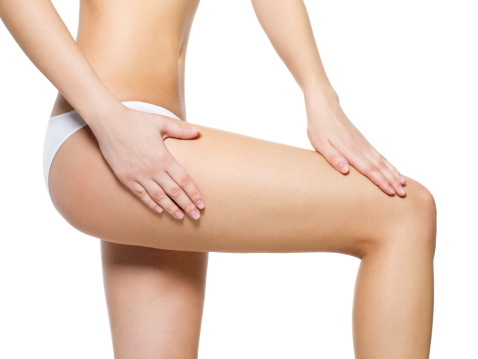 Female pampering skin on her legs