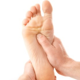 massage of one foot on white background